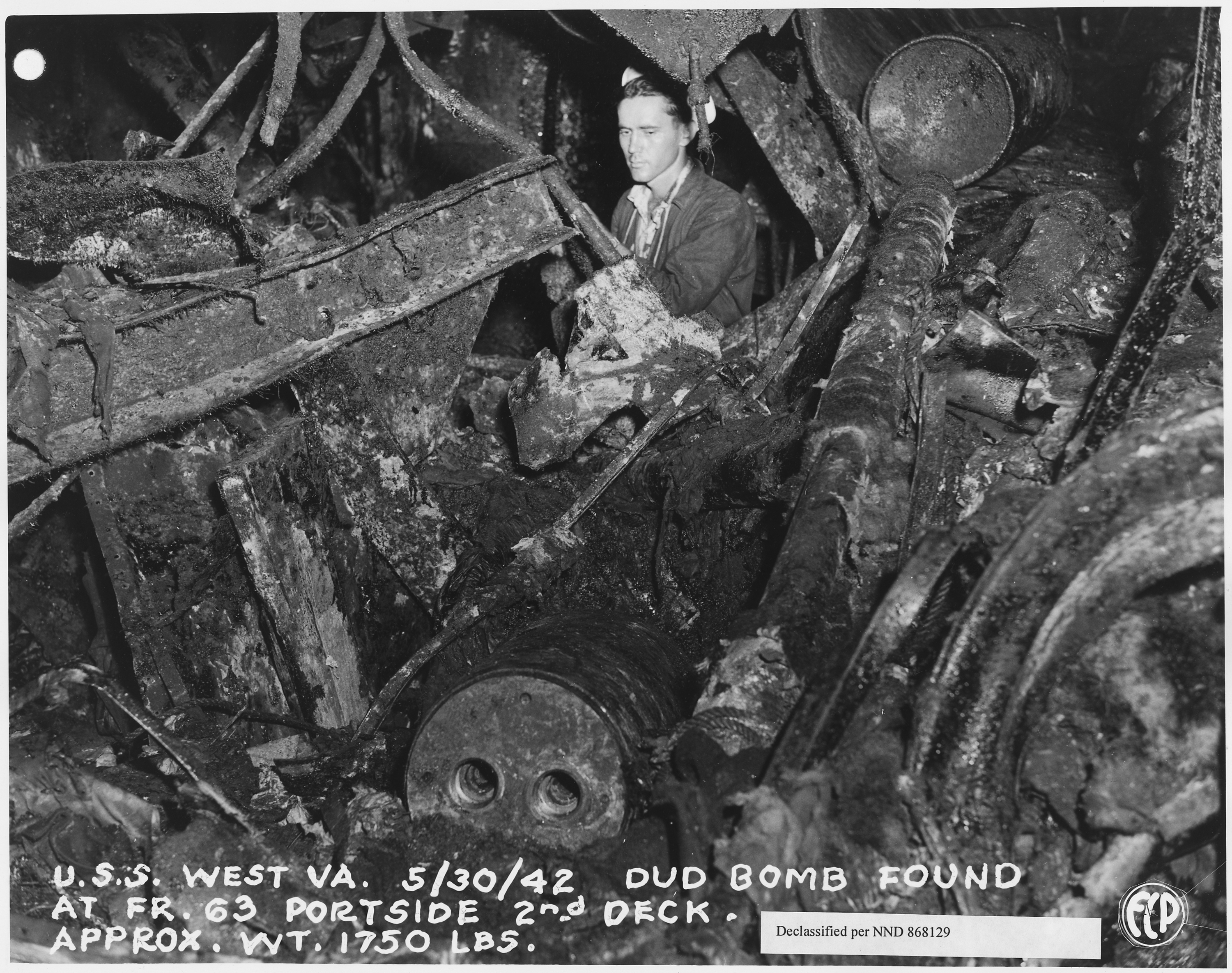 USS_West_Virginia_5-30-42,_Dud_bomg_found_at_Fr._63_Portside_2nd_deck._Approx._weight_1750_lbs._(FCP)_-_NARA_-_296916