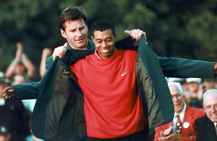 Woods getting the iconic green jacket PHOTO: Augusta.com