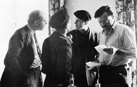 Original caption: Ernest Hemingway, (1899-1961),is shown here in the far right with John Dos Passos, (far left), Joris Evans, (back to camera) and Sidney Franklin, (American bullfighter) in Madrid during the Spanish Civil War.