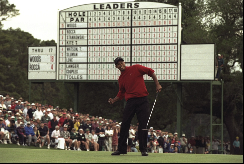 Woods after sinking the winning put PHOTO: Projectroto