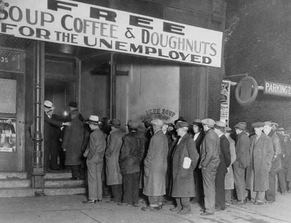 "16 Nov 1930, Chicago, Illinois, USA --- Notorious gangster Al Capone attempts to help unemployed men with his soup kitchen ""Big Al's Kitchen for the Needy.""  The kitchen provides three meals a day consisting of soup with meat, bread, coffee, and doughnuts, feeding about 3500 people daily at a cost of $300 per day. --- Image by © Bettmann/CORBIS"