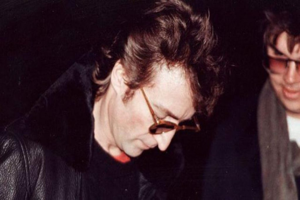 Photo taken of Chapman getting autograph from Lennon just hours before his death. Photo: vintage