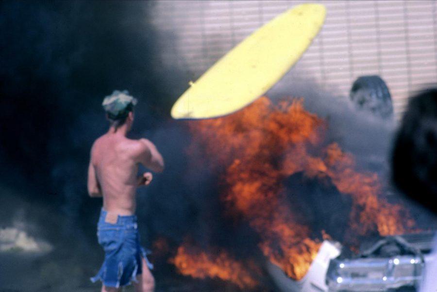 huntington-beach-surf-riots-surfboard-on-burning-car-900x602