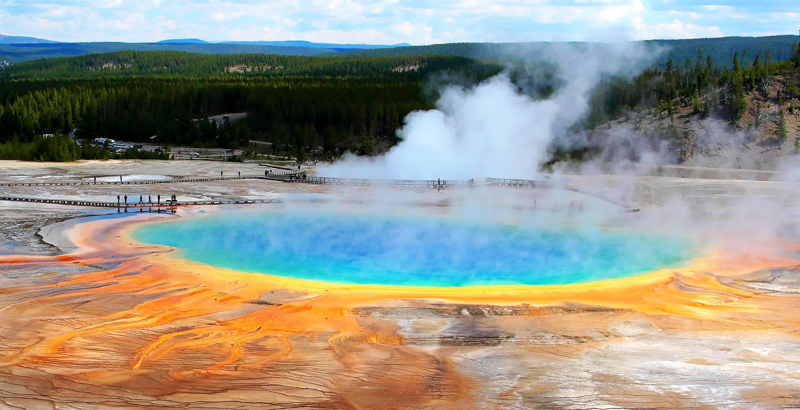 yellowstone national park Located primarily in the state of wyoming, yellowstone national park sits atop an enormous, slumbering supervolcano and is home to half of the world's geysers from a 300-foot-tall waterfall.