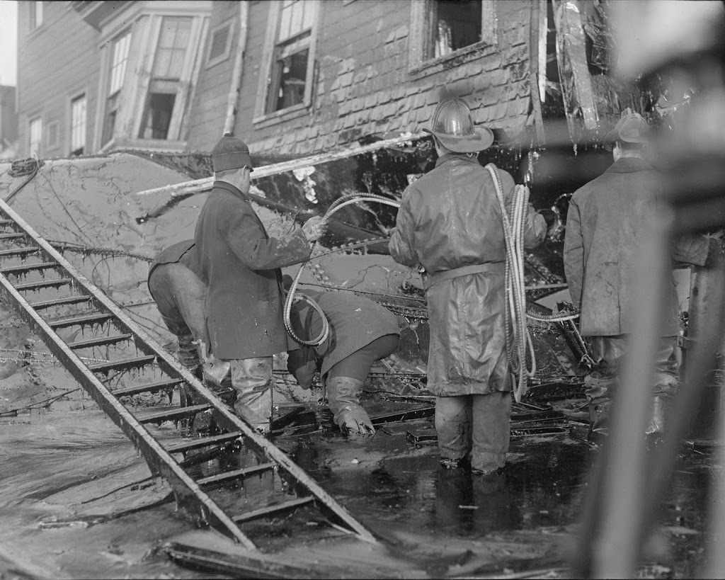 Firemen from engine 31 wading through the muck Photo: lostnewengland