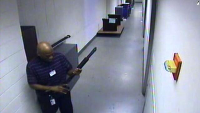 CCTV video of Alexis with his shotgun Photo: cnn