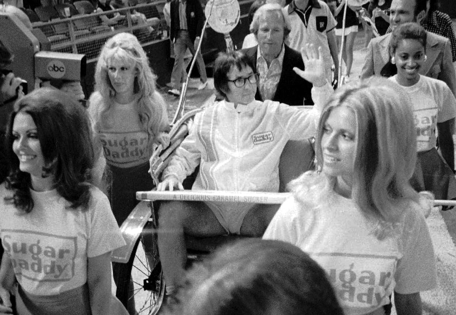 Bobby Riggs in a rickshaw pulled by beautiful women onto the court. Photo: chess