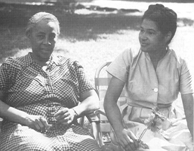 Clark with Rosa Parks. Source: blackpast.org