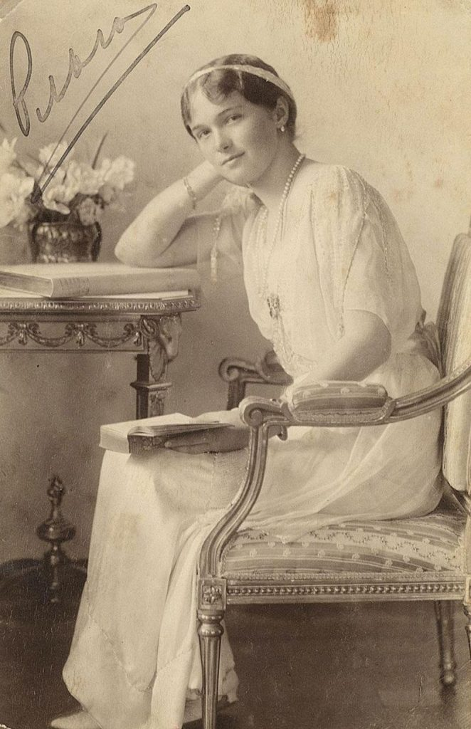 Formal portrait of Grand Duchess Olga in honour of the Romanov tercentenary in 1913.  Source: wikipedia.org